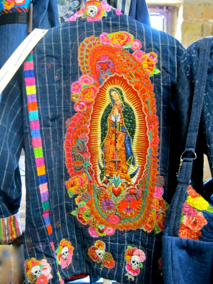 "Detail of the back of a coat called ""Day of the Dead Through the Eyes of the Soul"""