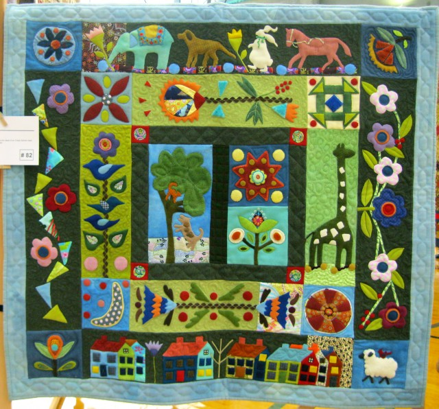 Folk Art Applique quilt, By Charlene Dakin