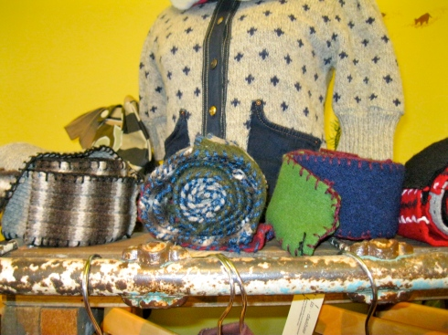 Scarves pieced from sweaters and embellished with yarn