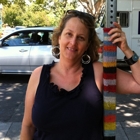 Alethea and the knitted sign post
