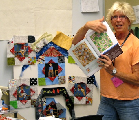 Diana Showing off Maverick Quilts!