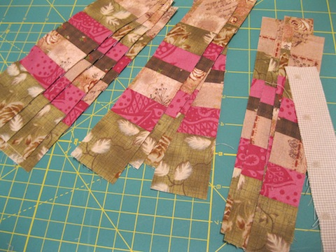 """Subcut the strips and add a 1"""" strip of the light fabric"""