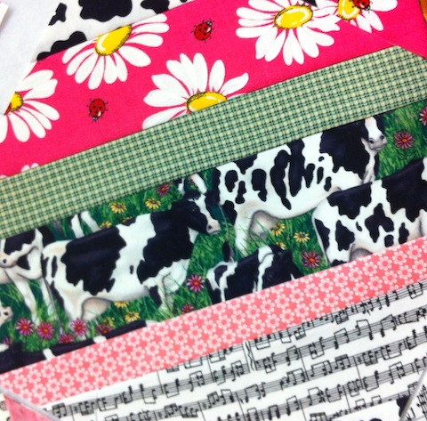 String-pieced cow quilt block