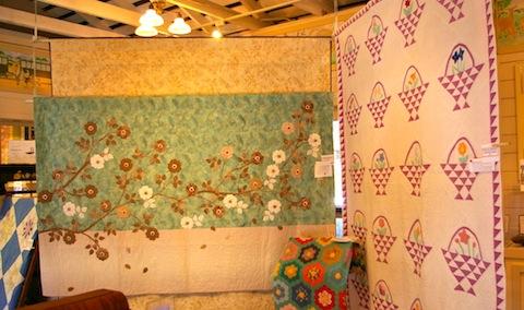 Jennifer Rounds' Zen Roses next to vintage quilts