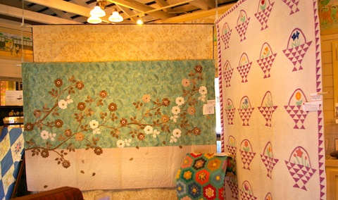 Jennifer Rounds' Zen Roses next to vintage quilts