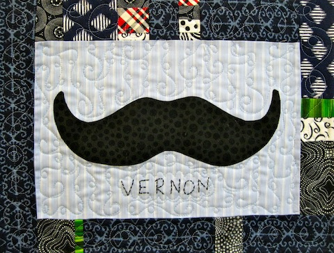 detail of Mini Awesome Mustache quilt!