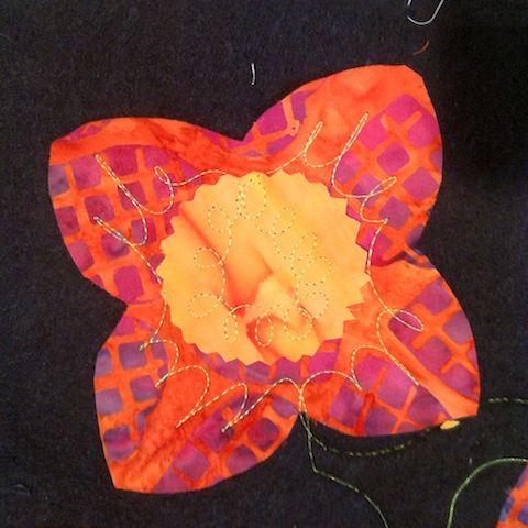 First layer of quilting for the orange flowers