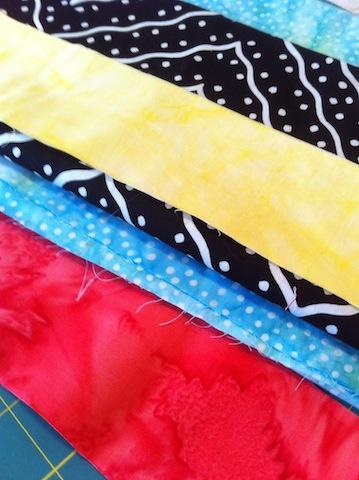 Auditioning fabrics for stripe inserts